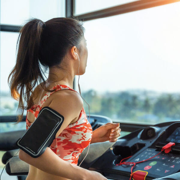 Woman exercising in a treadmill